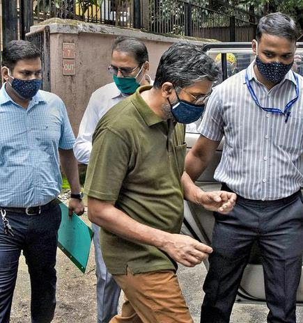 Professor Hany Babu (centre) being produced before the special NIA court in Mumbai. File