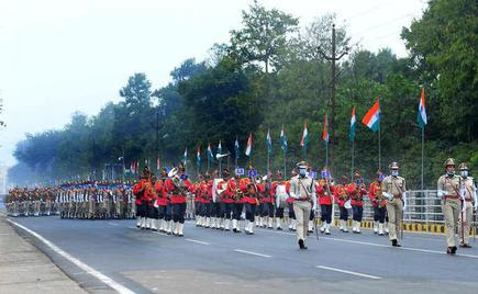 Soldiers march past at the Mahatma Gandhi marg on the occasion of Republic Day celebration in Bhubaneswar.