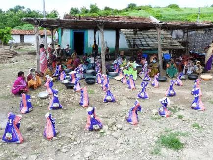 The Kumuram Bheem Asifabad district police keep ration bags to be distributed among the Kolam tribe people of Pangri habitation in Tiryani mandal.